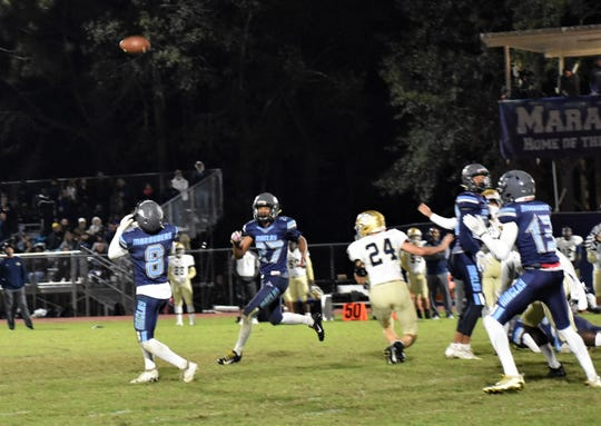 Maclay's Harrison Tate (54) blocked a 45-yard field goal that teammate Ian Widener (8) returned 65 yards for a touchdown, but Maclay fell 47-21 to Unviersity Christian in a Region 1-2A semifinal.