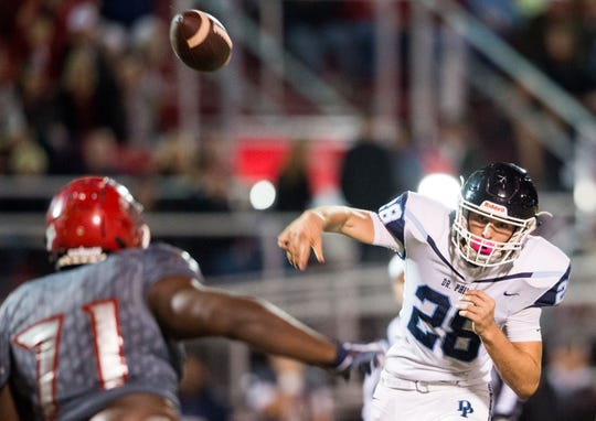 Dr. Phillips (Orlando) quarterback Brenden Cyr attempts a pass under pressure from Vero Beach during the first quarter of the Class 8A Regional Semifinal high school football game Friday, Nov. 16, 2018, at the Citrus Bowl in Vero Beach.