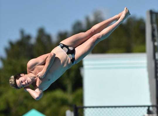 Jonathan Geraghty, of Lincoln Park Academy, performs a front one and one half with two twists dive in the 1-meter diving competition during the Florida High School Athletic Association Championship - Class 2A State swim meet at Sailfish Splash Waterpark on Saturday, Nov. 17, 2018, in Stuart.