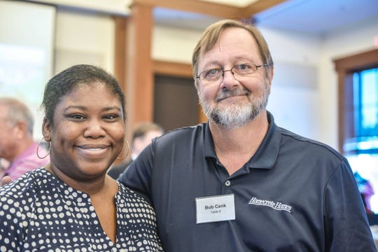 Latasha Blackmon, left, and Bob Cenk at the St. Lucie Habitat for Humanity Building Hope Breakfast. Cenk, of Homecrete Homes, is life director of the Treasure Coast Builders Association.