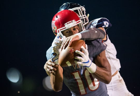 Vero Beach wide receiver Demarcus Harris stays in front of Dr. Phillips (Orlando) cornerback Bryan Bell-Anderson for a contested touchdown catch during the second quarter of the Class 8A Regional Semifinal high school football game Friday, Nov. 16, 2018, at the Citrus Bowl in Vero Beach.
