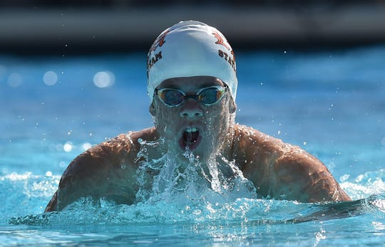 Jake Sciscente, of Lincoln Park Academy, competes in the second heat of the Boys 200 Yard IM preliminary race during the Florida High School Athletic Association Championship - Class 2A  State swim meet at Sailfish Splash Waterpark on Saturday, Nov. 17, 2018, in Stuart.