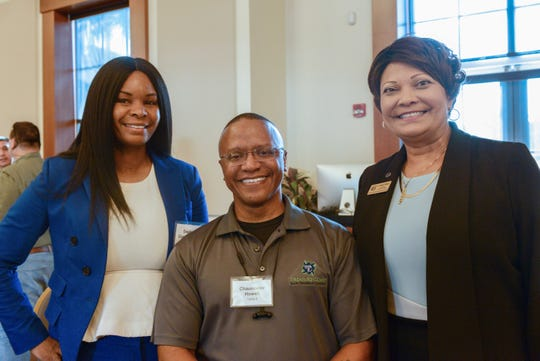 Dr. Daphne Cooper, left, Chauncelor Howell and Dr. Pamela Welmon at the St. Lucie Habitat for Humanity Building Hope Breakfast.