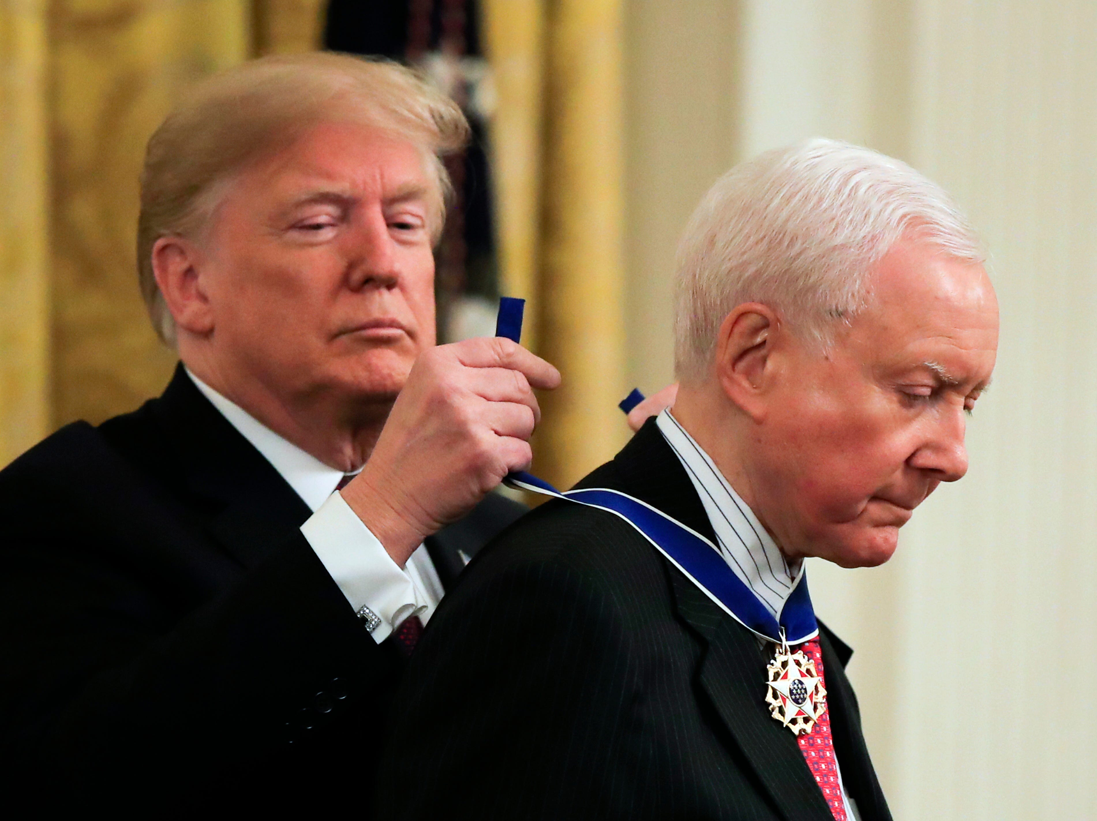 President Donald Trump presents the Presidential Medal of Freedom to U.S. Sen. Orrin Hatch, R-Utah during a ceremony in the East Room of the White House, in Washington, D.C., on Friday, Nov. 16, 2018.