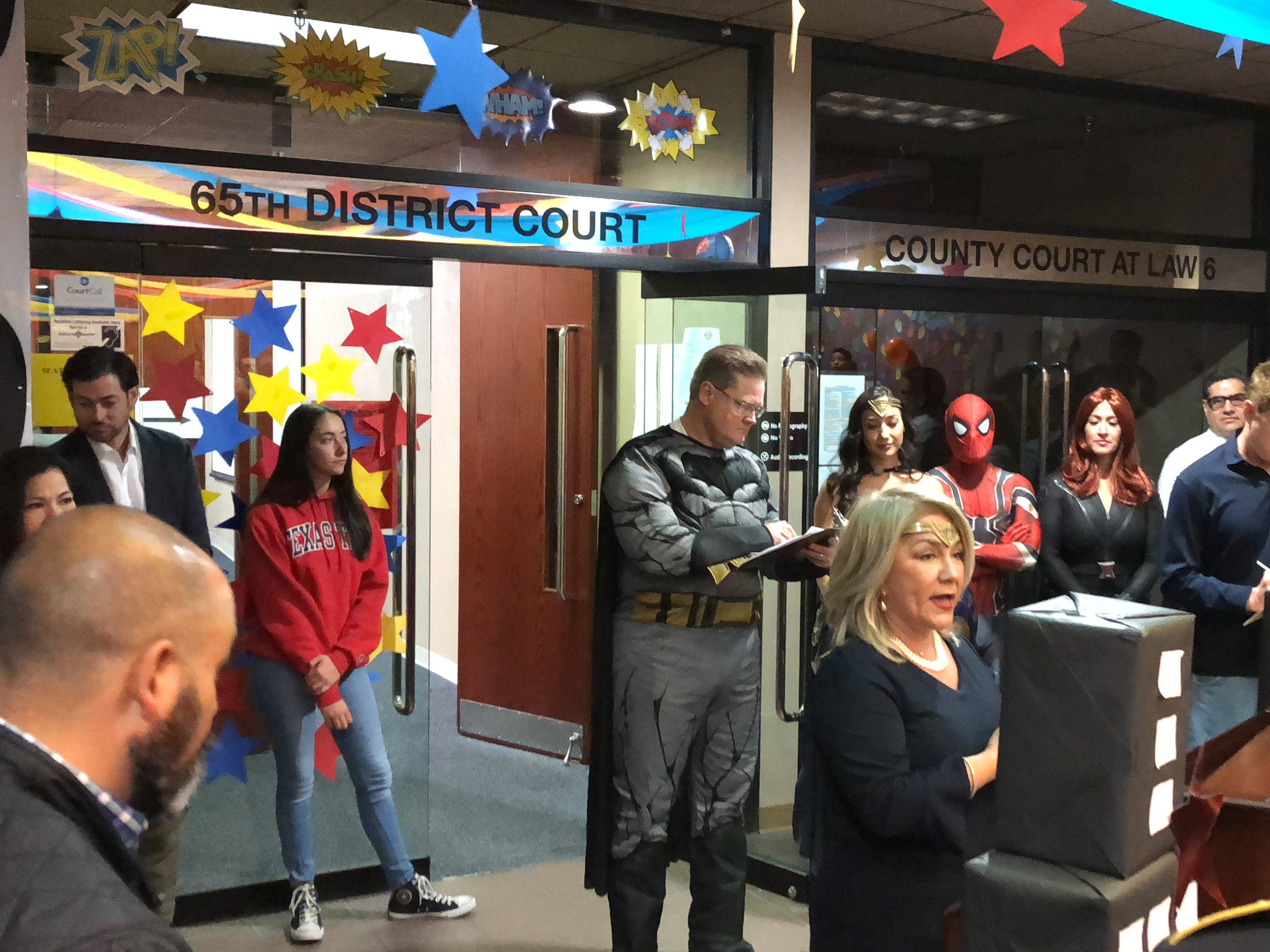 A National Adoption Day event was held Saturday, Nov. 17, 2018, at the El Paso County Courthouse. A total of 29 children were officially adopted by 12 El Paso families. 65th District Court Judge Yahara Lisa Gutierrez addresses the families while the bailiff, dressed as Batman, calls out names.