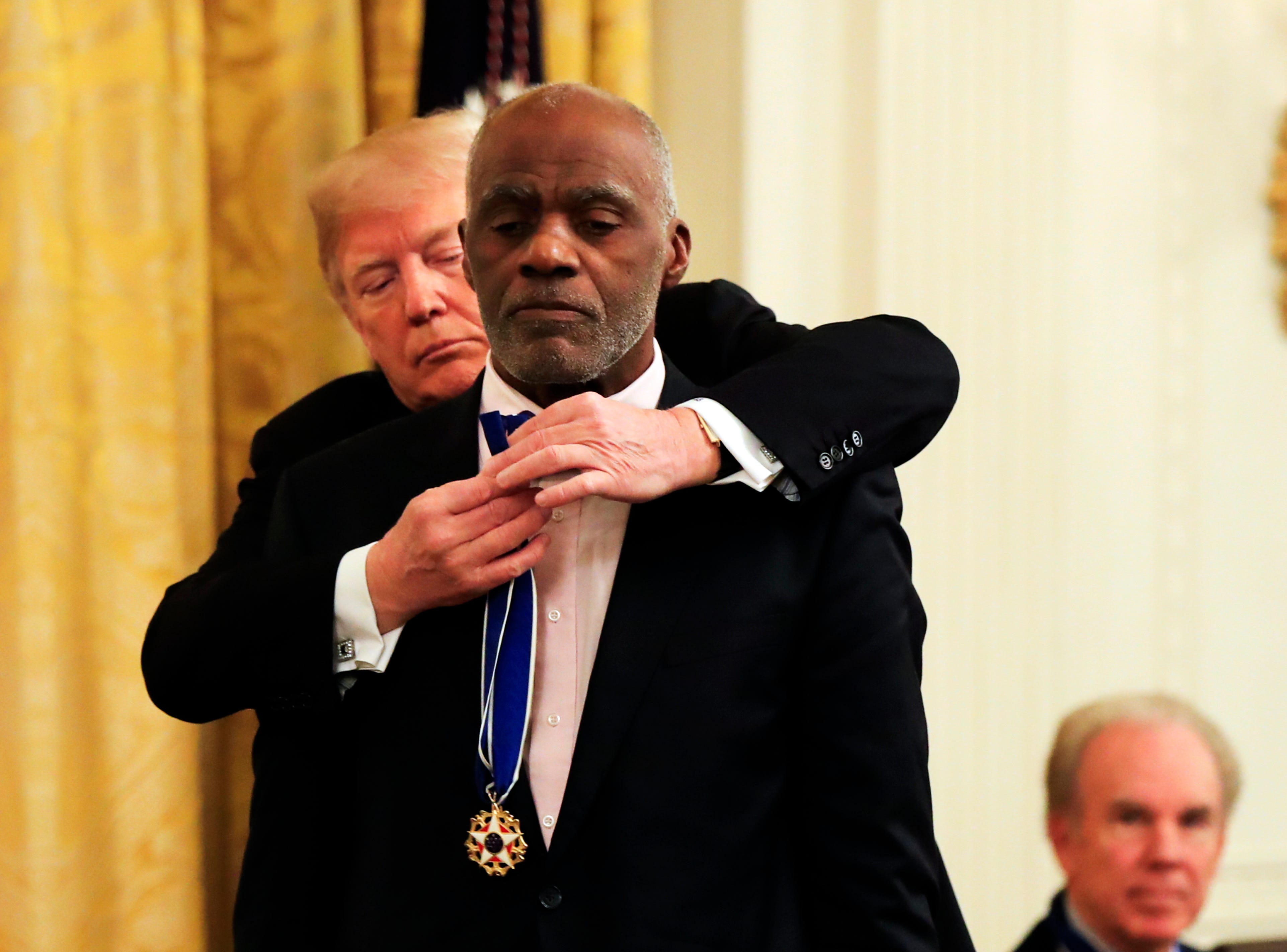 President Donald Trump presents the Presidential Medal of Freedom to retired Minnesota Supreme Court Justice Alan Page during a ceremony in the East Room of the White House, in Washington, D.C., on Friday, Nov. 16, 2018.