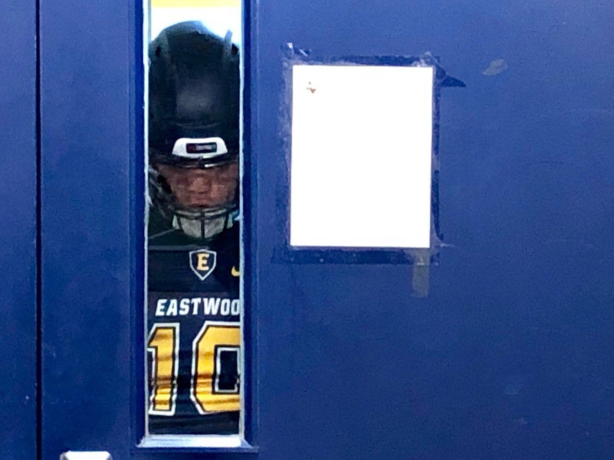 An Eastwood Trooper player waits by the doorway before the team leaves the locker room for their game with Abilene Cooper Friday night at Trooper Stadium.@TroopAthletics @Coopercoogs1