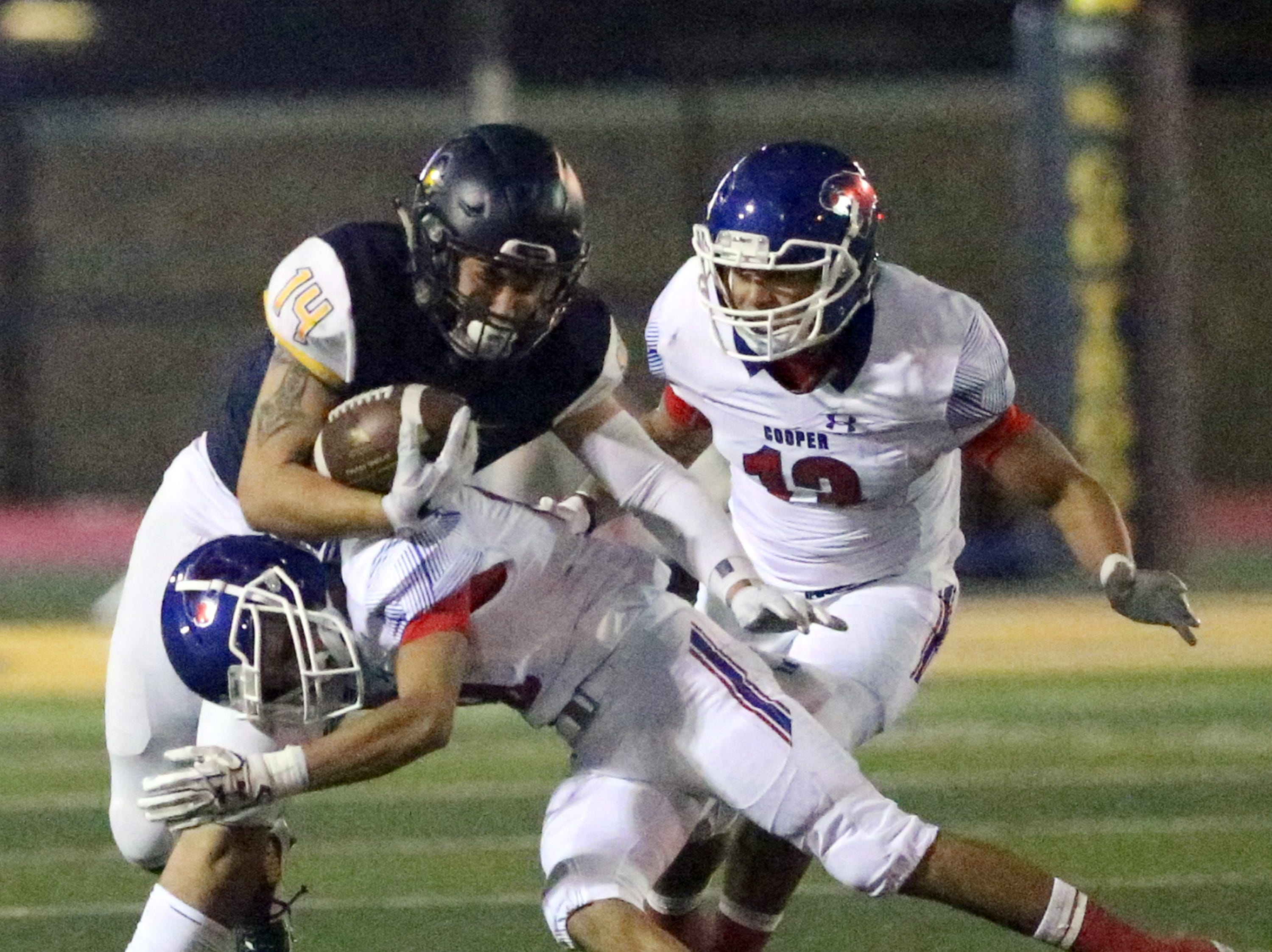 Nathan Samaniego, 14, of Eastwood heads downfield before being stopped by Abilene Cooper defenders Friday night.