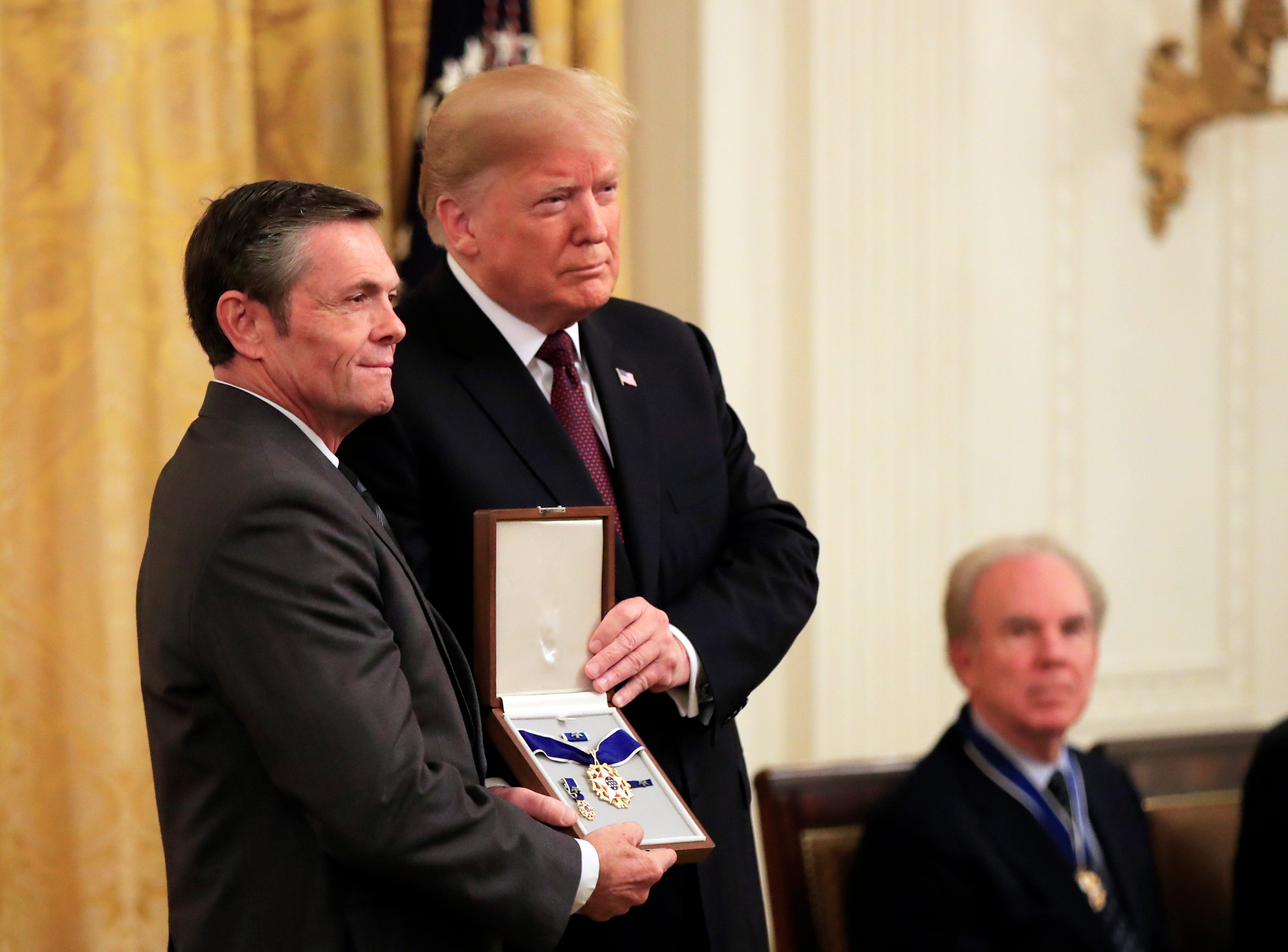 Thomas Stevens, grandson of Babe Ruth, accepts the Presidential Medal of Freedom on behalf of the Ruth family from President Donald Trump during a ceremony in the East Room of the White House in Washington, D.C., on Friday, Nov. 16, 2018.