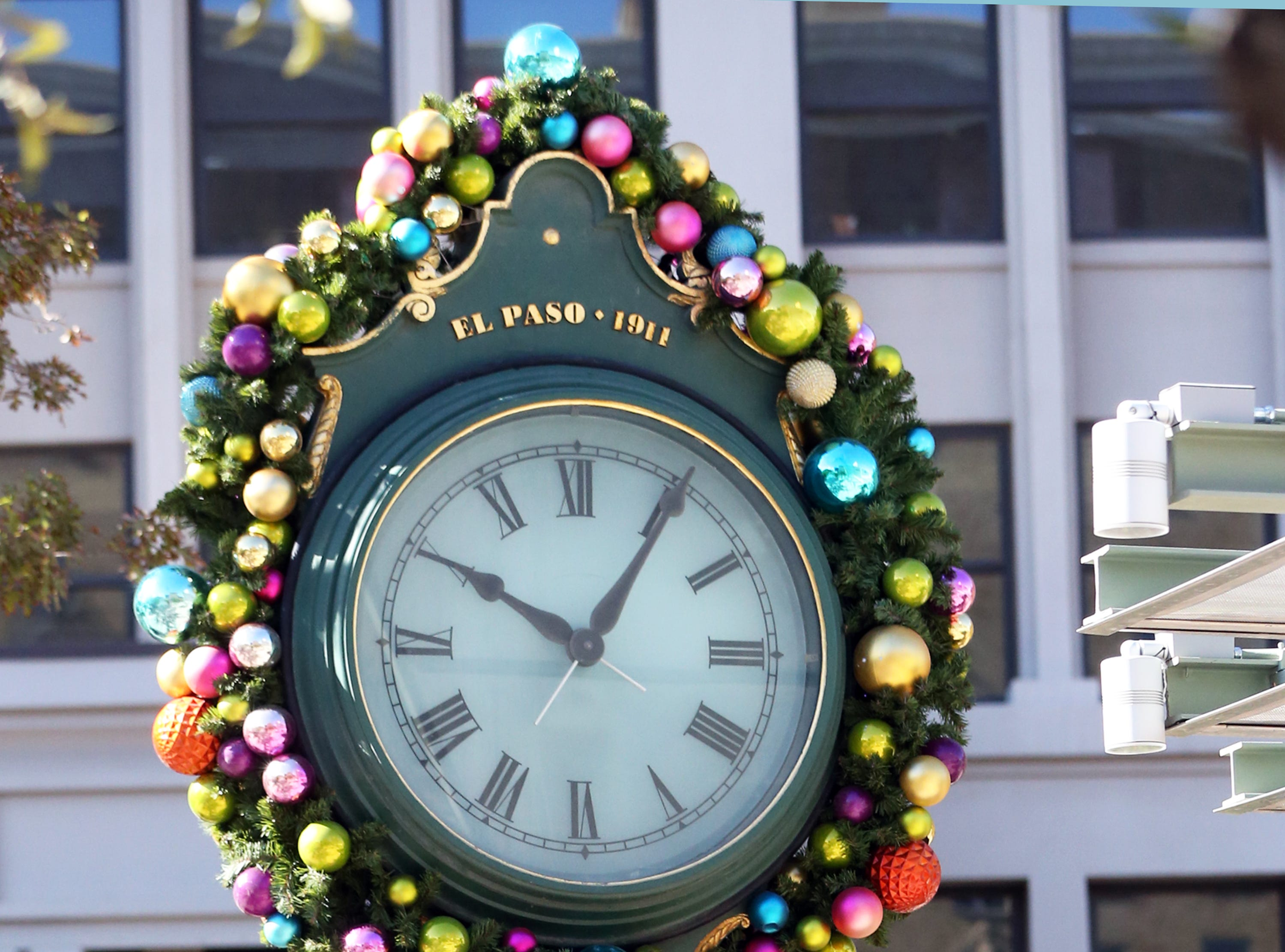 The city's historic town clock in San Jacinto Plaza is decorated for the Christmas holiday season.