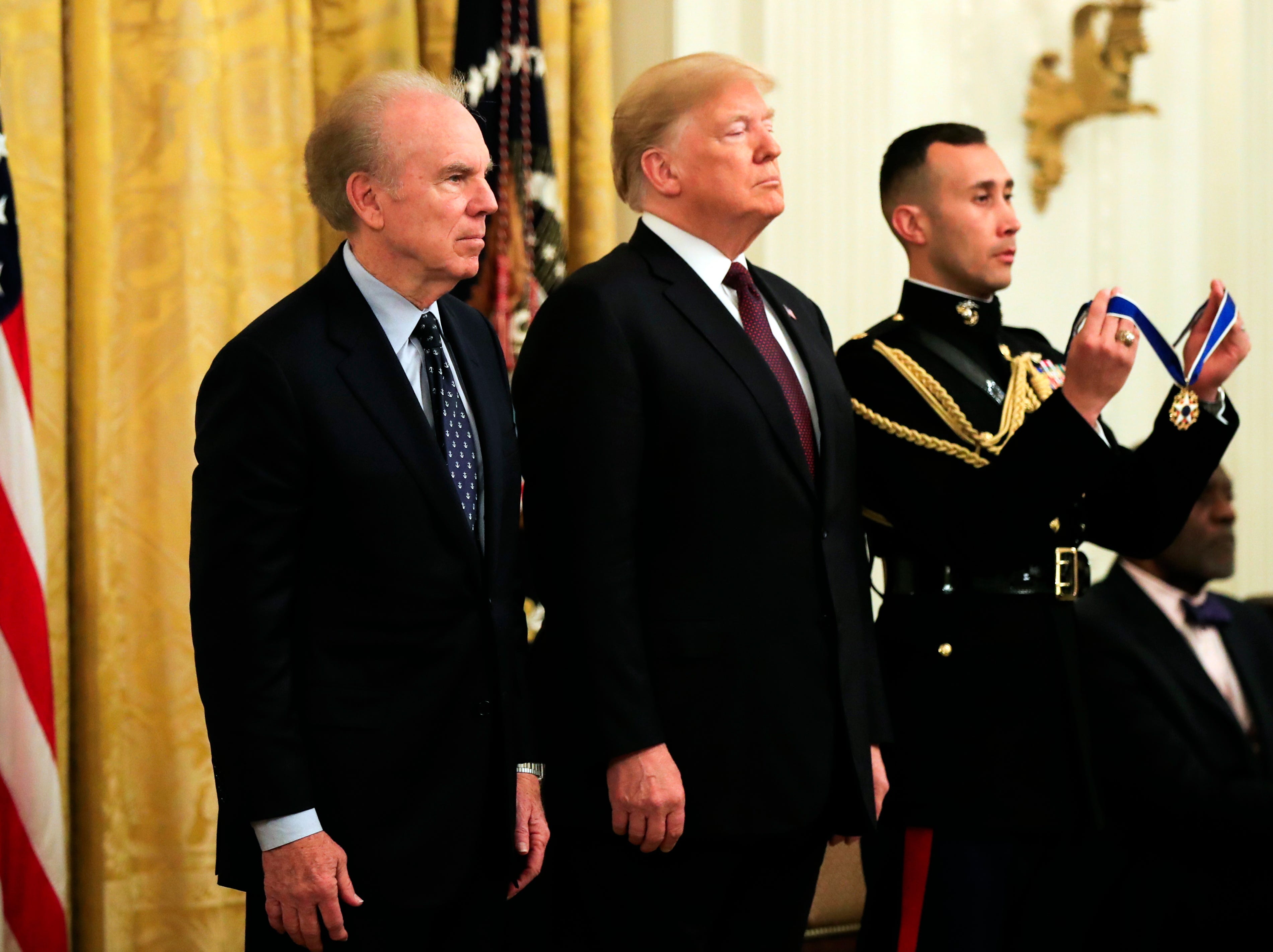 President Donald Trump presents the Presidential Medal of Freedom to Roger Staubach, left, during a ceremony in the East Room of the White House, in Washington, D.C., on Friday, Nov. 16, 2018.