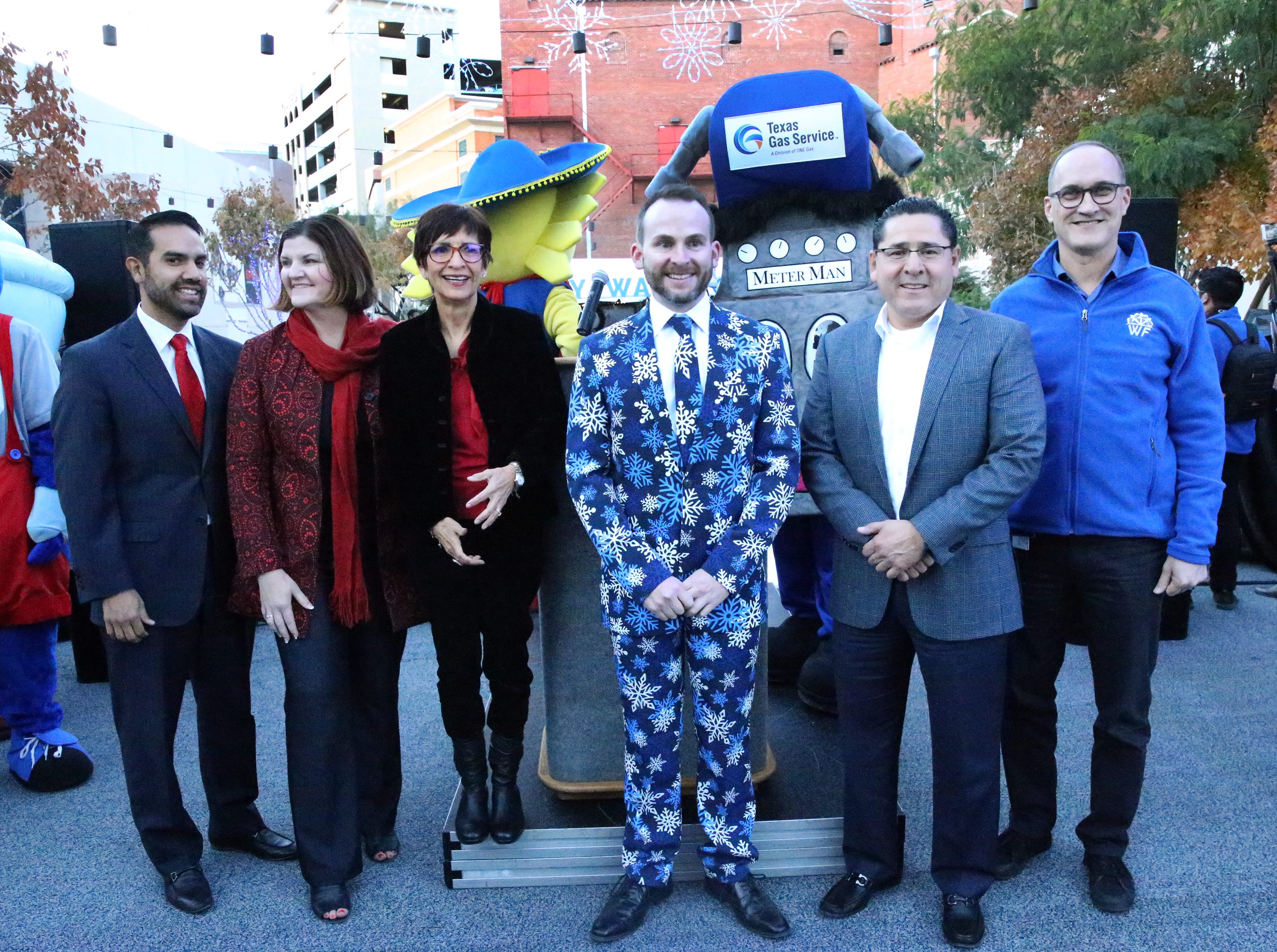 "Bryan Crow, center, general manager of Destination El Paso with dignitaries at the ""Break The Ice' party and press conference to kick off WinterFest 2018 at Downtown Festival Plaza Friday."