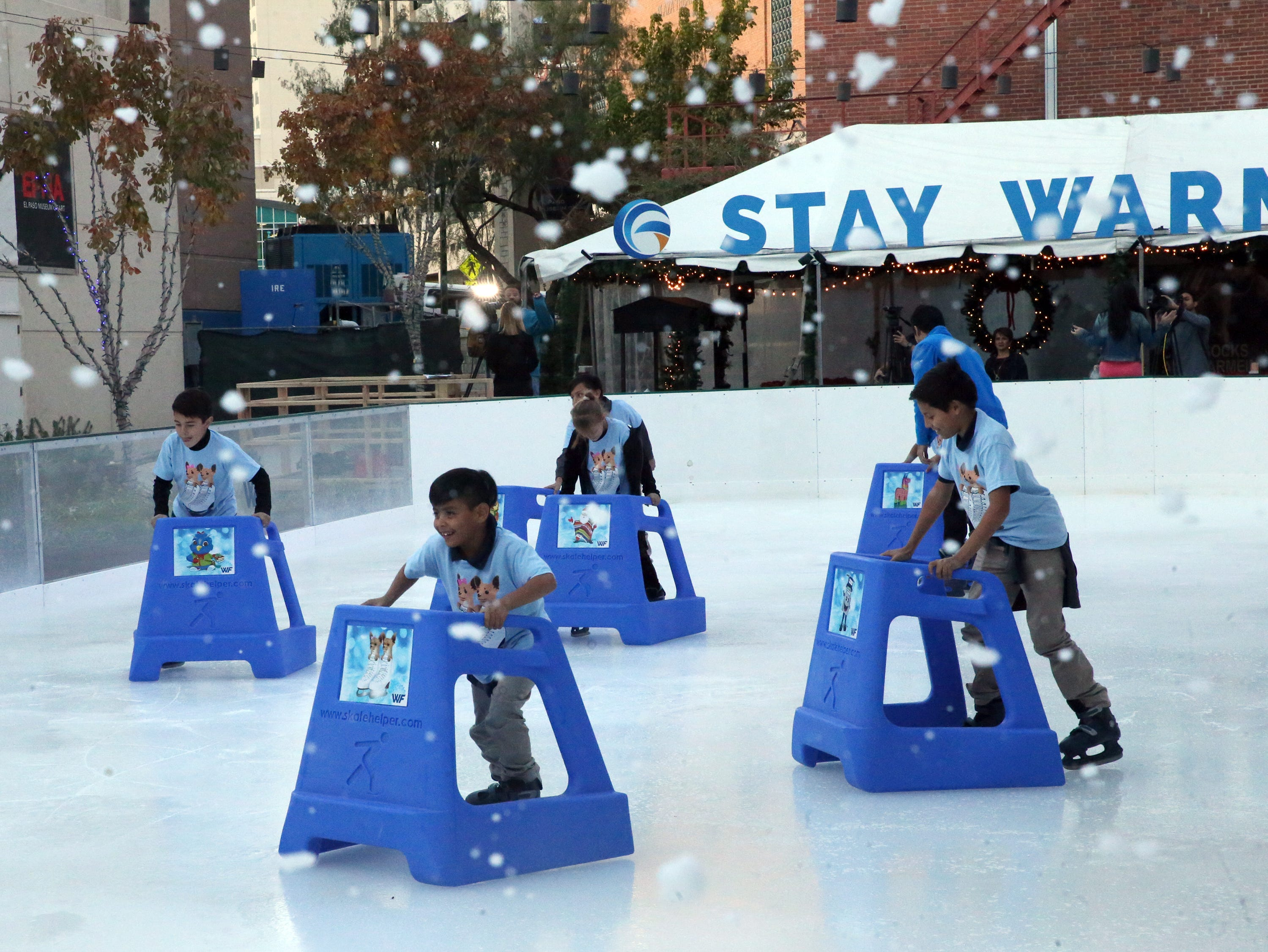 Kids from the Boys and Girls Clubs of El Paso are the first to get onto the ice rink during a 'Break The Ice' party and press conference to kick off WinterFest 2018 Friday in downtown El Paso.