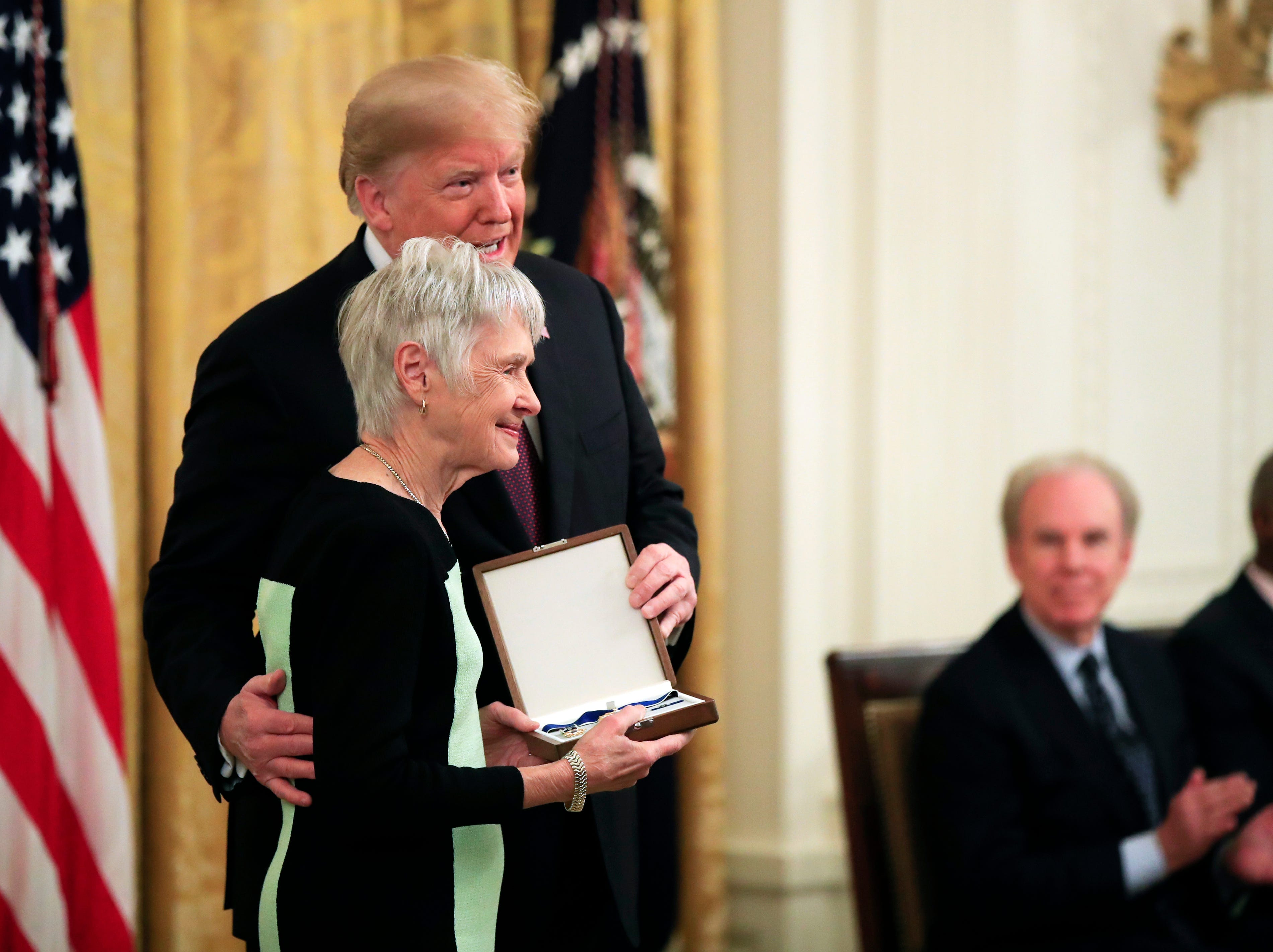 Maureen Scalia, widow of U.S. Supreme Court Justice Antonin Scalia, receives her husband's Presidential Medal of Freedom during a ceremony in the East Room of the White House, in Washington, D.C., on Friday, Nov. 16, 2018.