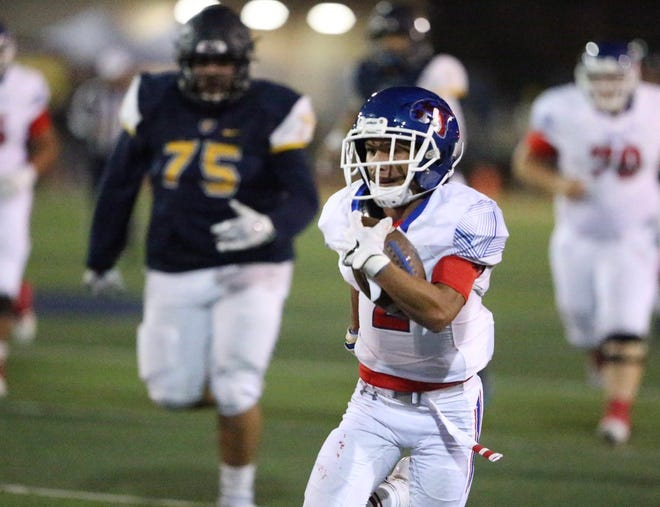 Daelin Campos breaks for 53 yards to score Cooper's second touchdown of the first quarter against El Paso Eastwood at Trooper Stadium in El Paso.