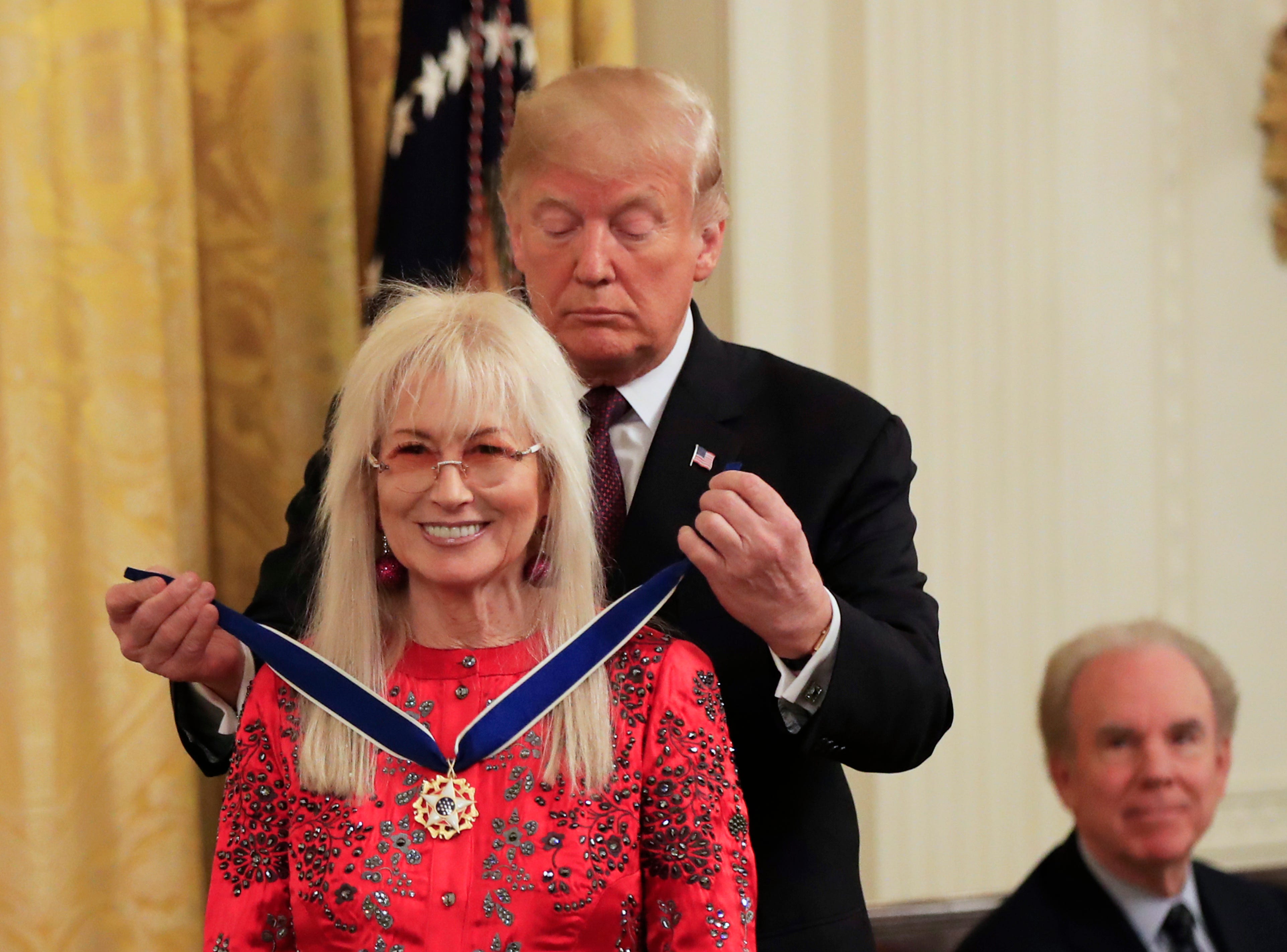 President Donald Trump presents the Presidential Medal of Freedom to Miriam Adelson during a ceremony in the East Room of the White House, in Washington, D.C., on Friday, Nov. 16, 2018.