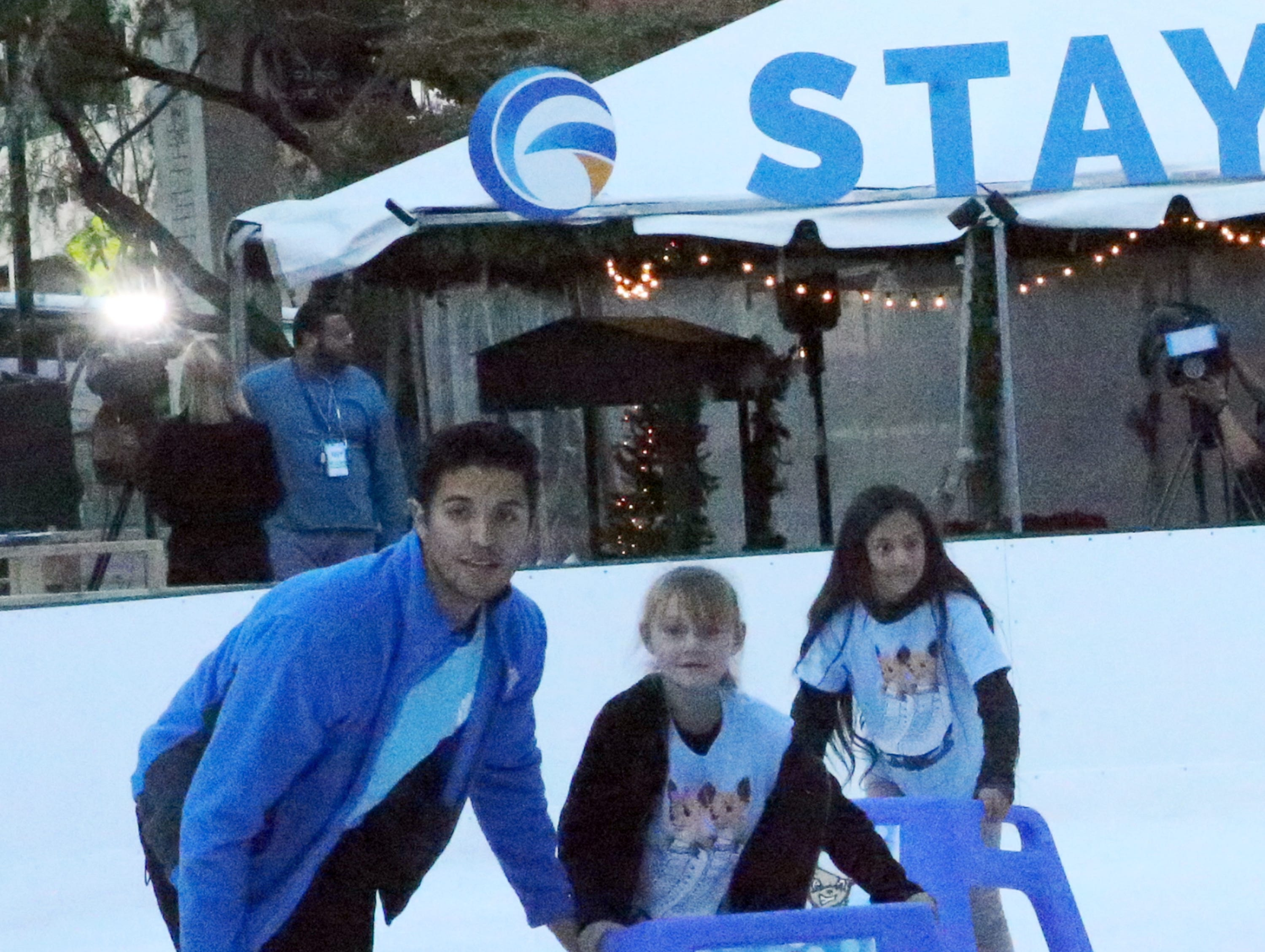 "Children from the Boys and Girls Clubs of El Paso try out the ice rink at WinterFest 2018 during a private ""Break the Ice"" event and news conference Friday."