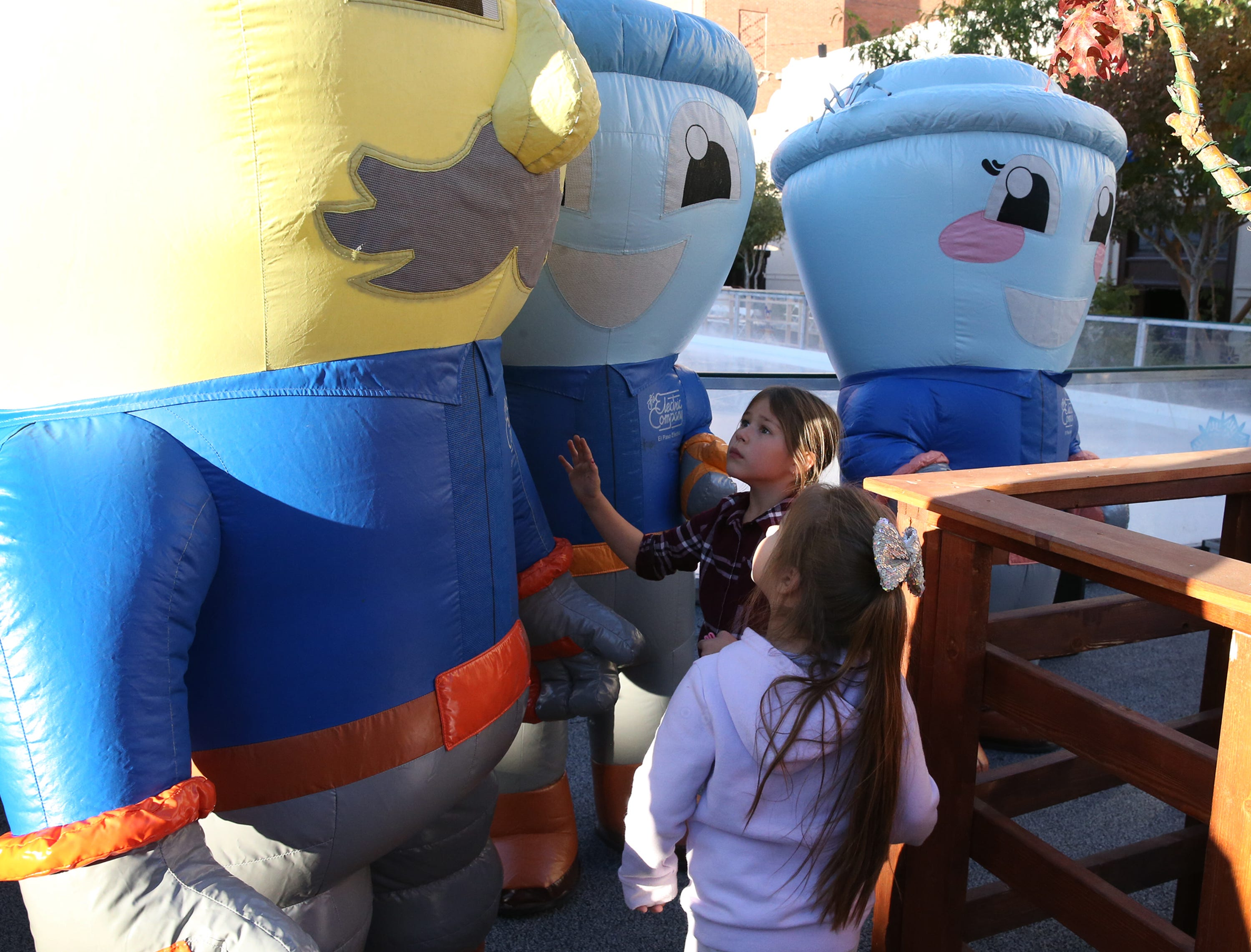 Kids walk up to get a closer look at El Paso Electric Company mascots at the 'Break The Ice' party and press conference to kick off WinterFest 2018 Friday in downtown El Paso.