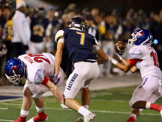Cooper's Justin DeLeon, right, gets his hands on the ball as teammate Brady Miller also defends against an El Paso Eastwood receiver Evan Gonzales. Cooper won the Region I-5A Division I bi-district playoff game 49-41 on Friday, Nov. 16, 2018, at Trooper Field in El Paso.