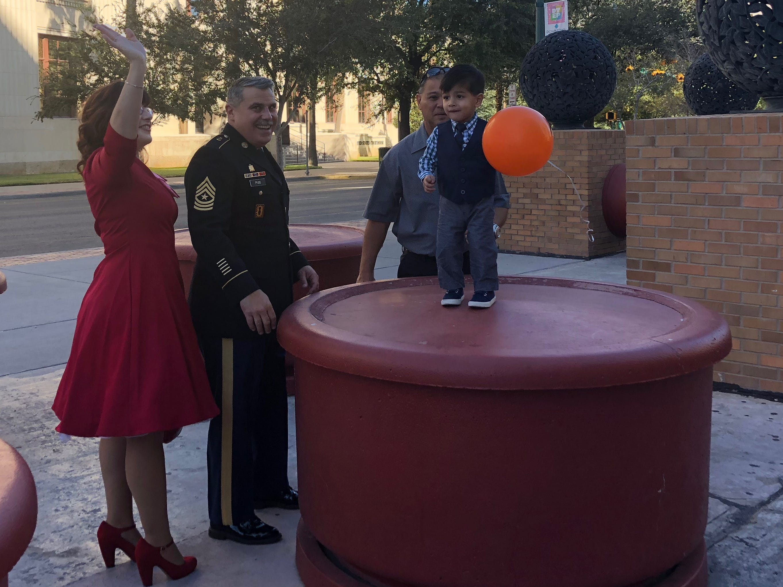 """David Puig and Linda Lopez-Puig celebrate Saturday, Nov. 17, 2018, after officially adopting Ayden at the El Paso County Courthouse. They had taken in Ayden as a foster child while he was recovering from a life-threatening situation. Puig is a soldier and teacher at the Sergeants Major Academy and Lopez-Puig is a homemaker. Puig said he'll retire in El Paso after 35 years in the Army, but they don't know yet if they'll stay here. """"This is our last duty station,"""" Lopez-Puig said. """"We'll go where Ayden needs us to be."""""""
