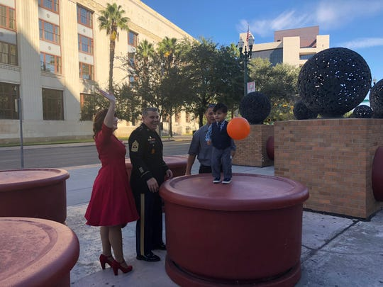"David Puig and Linda Lopez-Puig celebrate Saturday, Nov. 17, 2018, after officially adopting Ayden at the El Paso County Courthouse. They had taken in Ayden as a foster child while he was recovering from a life-threatening situation. Puig is a soldier and teacher at the Sergeants Major Academy and Lopez-Puig is a homemaker. Puig said he'll retire in El Paso after 35 years in the Army, but they don't know yet if they'll stay here. ""This is our last duty station,"" Lopez-Puig said. ""We'll go where Ayden needs us to be."""