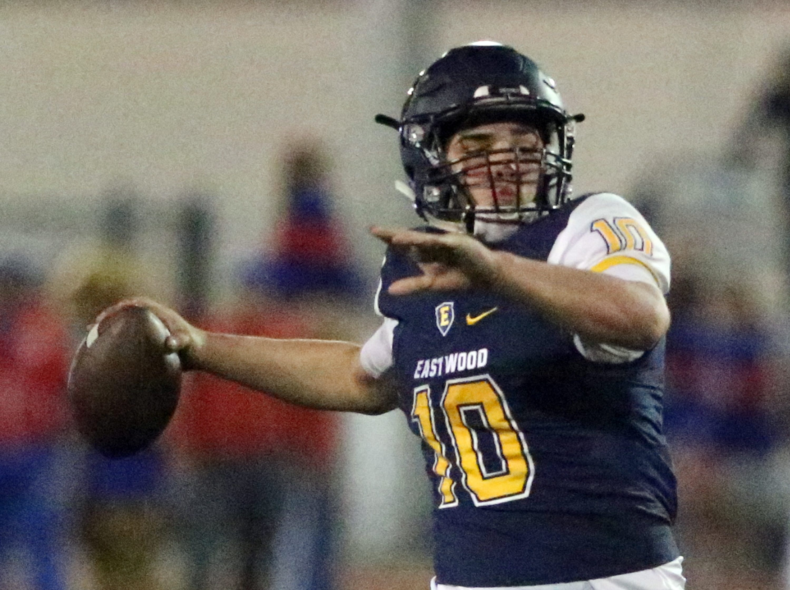 Eastwood quarterback Christian Castaneda finds a receiver before unloading a pass for a touchdown against Abilene Cooper Friday night.