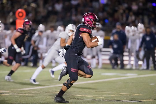 Zach Charbonnet races for a 61-yard touchdown run during Oaks Christian's loss to top-ranked St. John Bosco in a Division 1 semifinal game Friday night at Oaks Christian School.