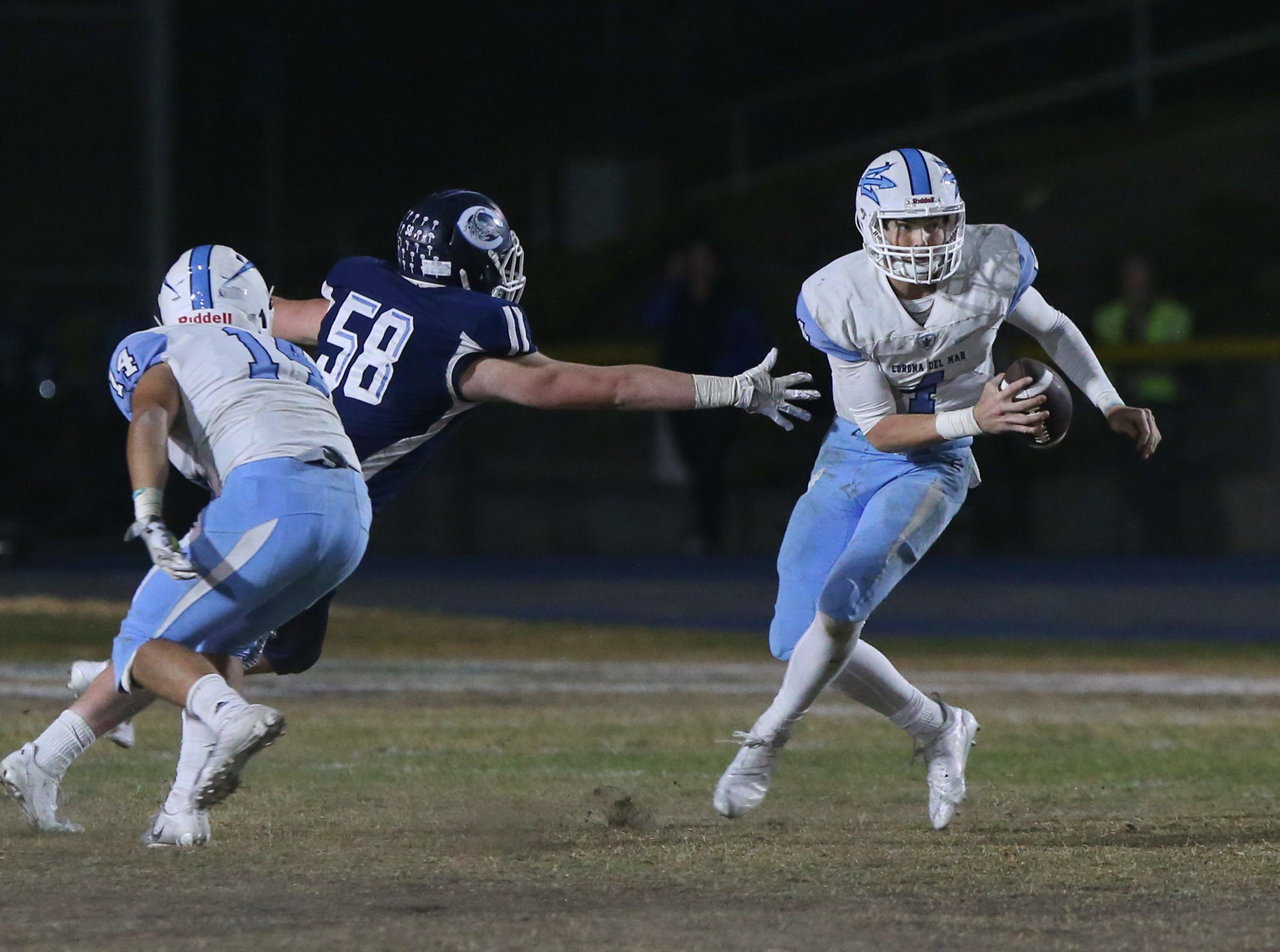 Camarillo High's Aaron Lavelle (58) tries to reach Corona del Mar quarterback Ethan Garbers during their CIF-SS Division 4 semifinal game on Friday.