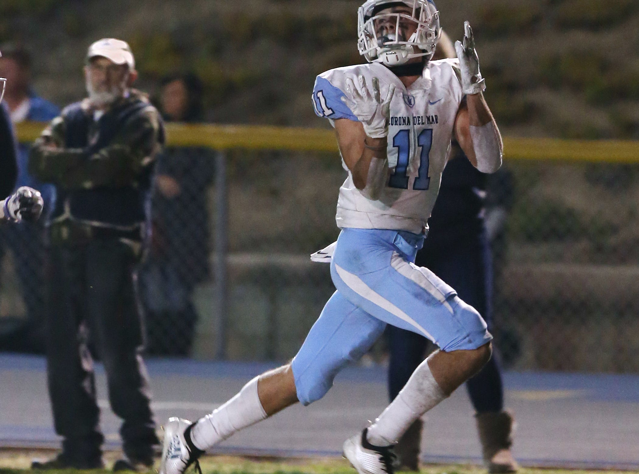 Corona del Mar's Jesse Bradley Schlom makes a touchdown catch against Camarillo during Friday night's playoff game.