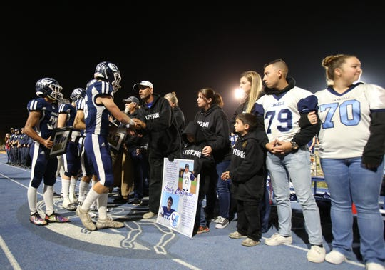 Jason Coffman, the father of Cody Gifford-Coffman, thanks Camarillo High football players after the team honored his son, who was killed in the mass shooting at Borderline Bar & Grill in Thousand Oaks last week, before Friday night's home playoff game against Corona del Mar. Cody Gifford-Coffman was a former player and graduate of Camarillo High. The Scorpions lost the semifinal game, 49-17.