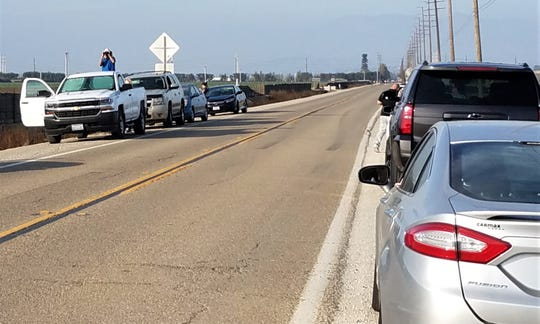 People lined the roadway Saturday as close as they could get to Point Mugu ahead of President Donald Trump's arrival.