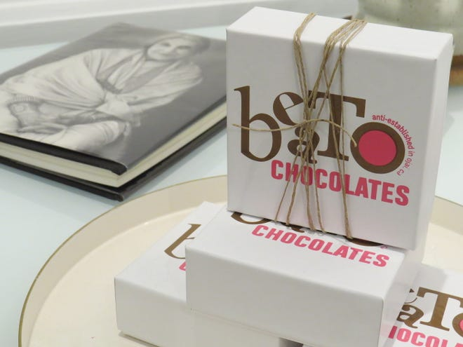 Boxes of Beato Chocolates are displayed next to a book about the life of the late Ojai artist, Beatrice Wood, who was also known as Beato. The chocolates are made and sold at The Porch Gallery in Ojai.