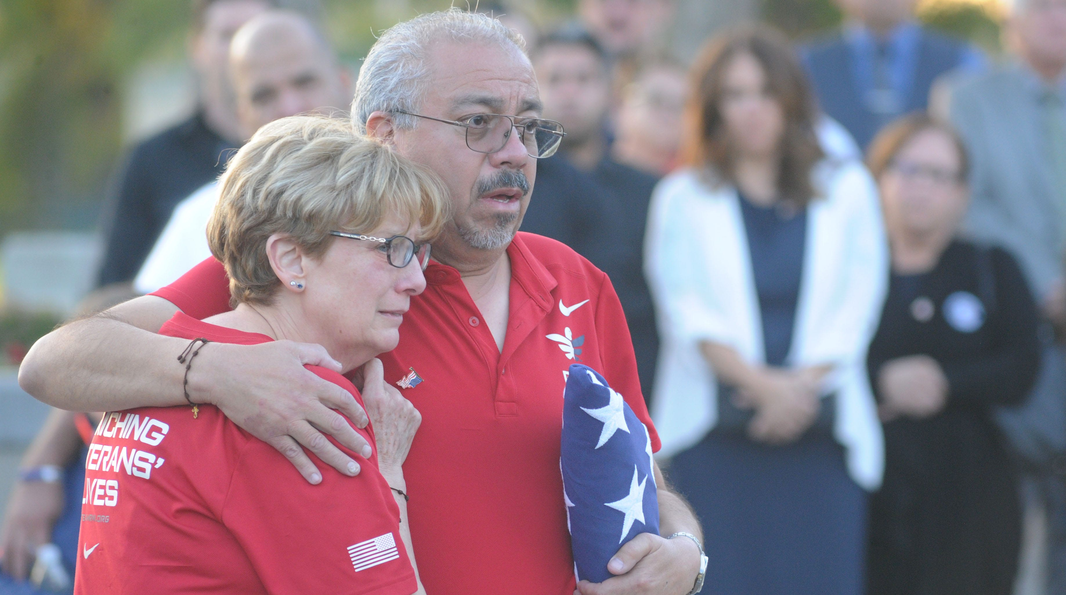 Elsa Manrique and her husband, Mario Manrique, watch the casket of their son  Daniel Manrique being taken to the hearse at Calvary Community Church. Dan Manrique, a Marine Corps veteran, was one of the 12 people slain in the Borderline Bar & Grill shooting.