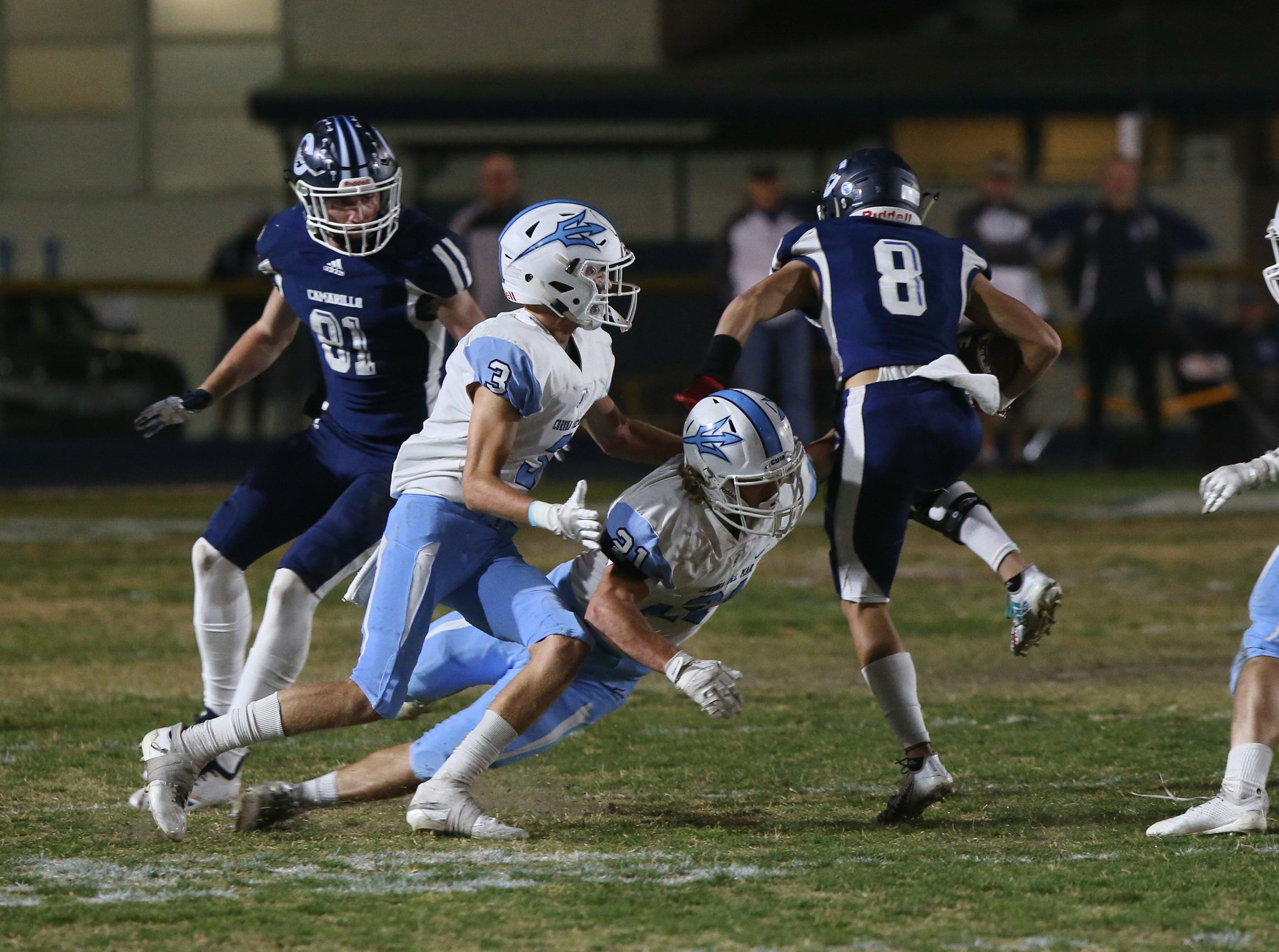 Corona del Mar's Franz Froehlich tackles Camarillo's Mason Brown during their CIF-SS Division 4 semifinal game on Friday night.