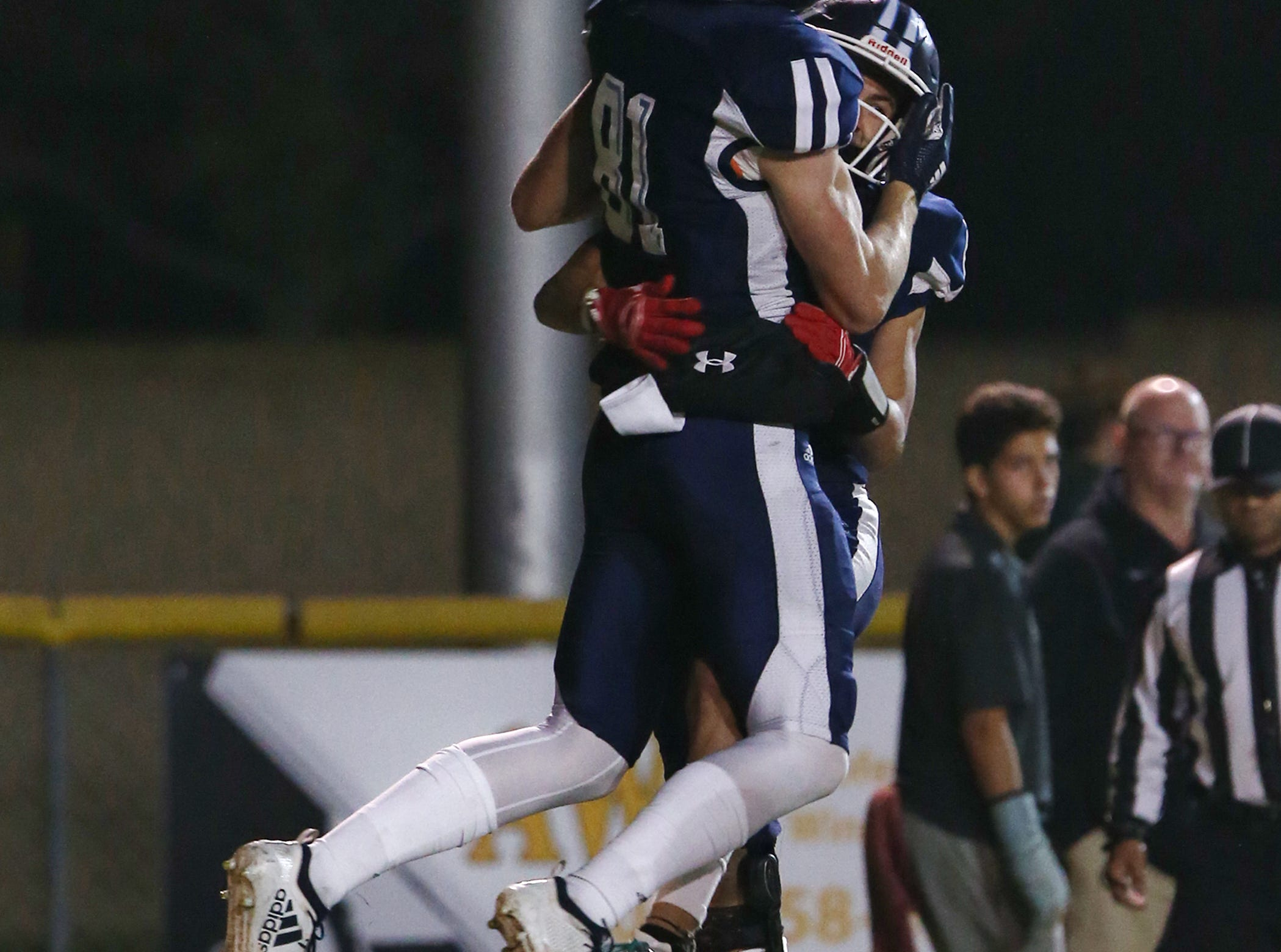 Camarillo High's Peter Dufau and Matthew Miller celebrate after Dufau scored a touchdown during the Scorpions' loss to Corona del Mar in a Division 4 semifinal game Friday night.