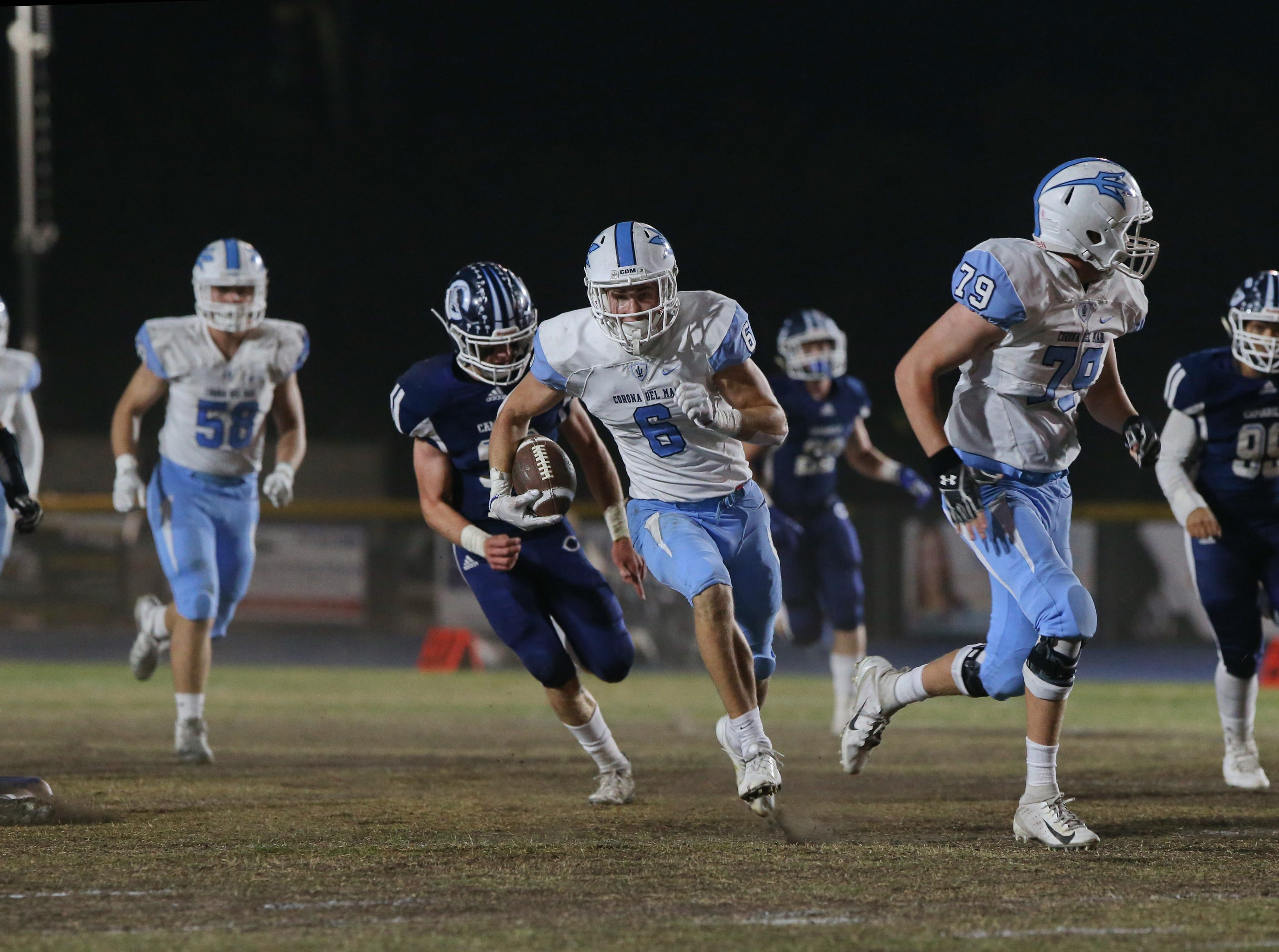 Corona del Mar's John Humphreys finds an opening in the Camarillo defense during Friday night's Division 4 semifinal.