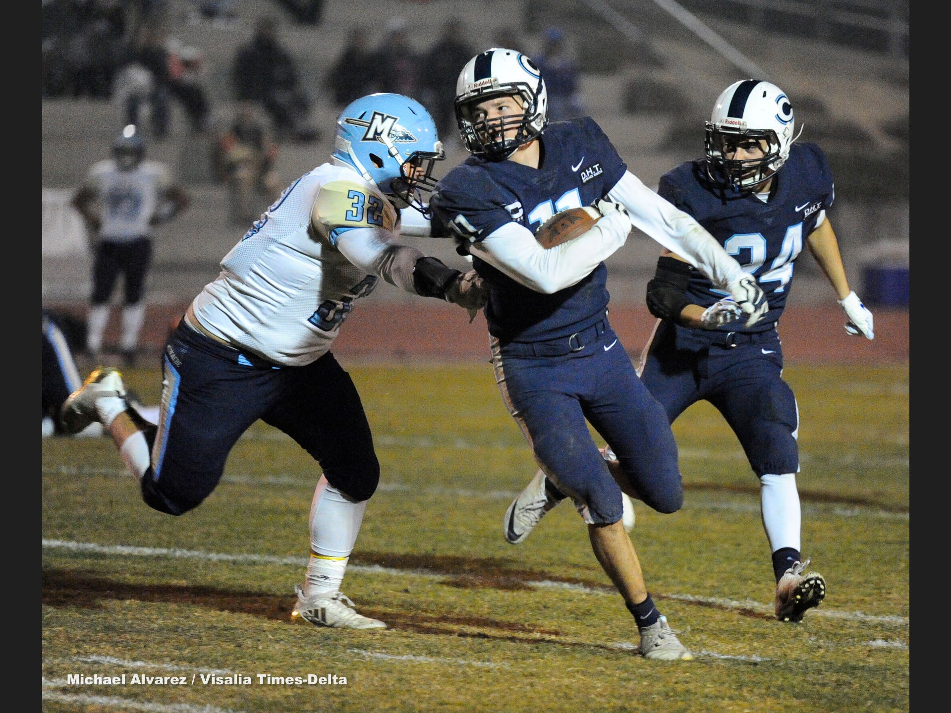 Central Valley Christian Simon Tevelde runs past the reaching arms of Monache Troy Carlos during the Central Section Division IV playoff on November 16, 2018.