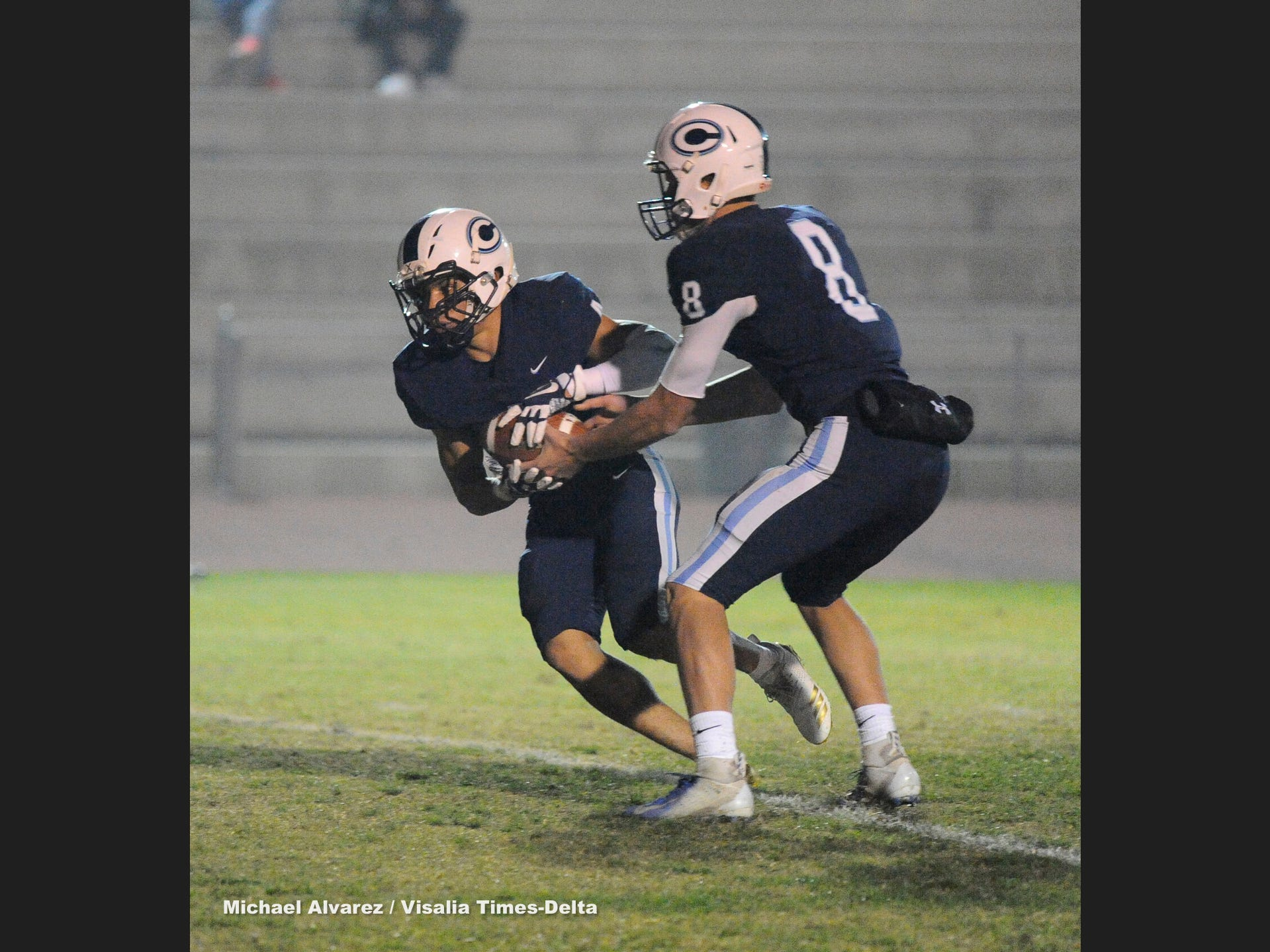 Central Valley Christian Eric Dragt hands off the ball to Jaalen Rening during the Central Section Division IV playoff on November 16, 2018.