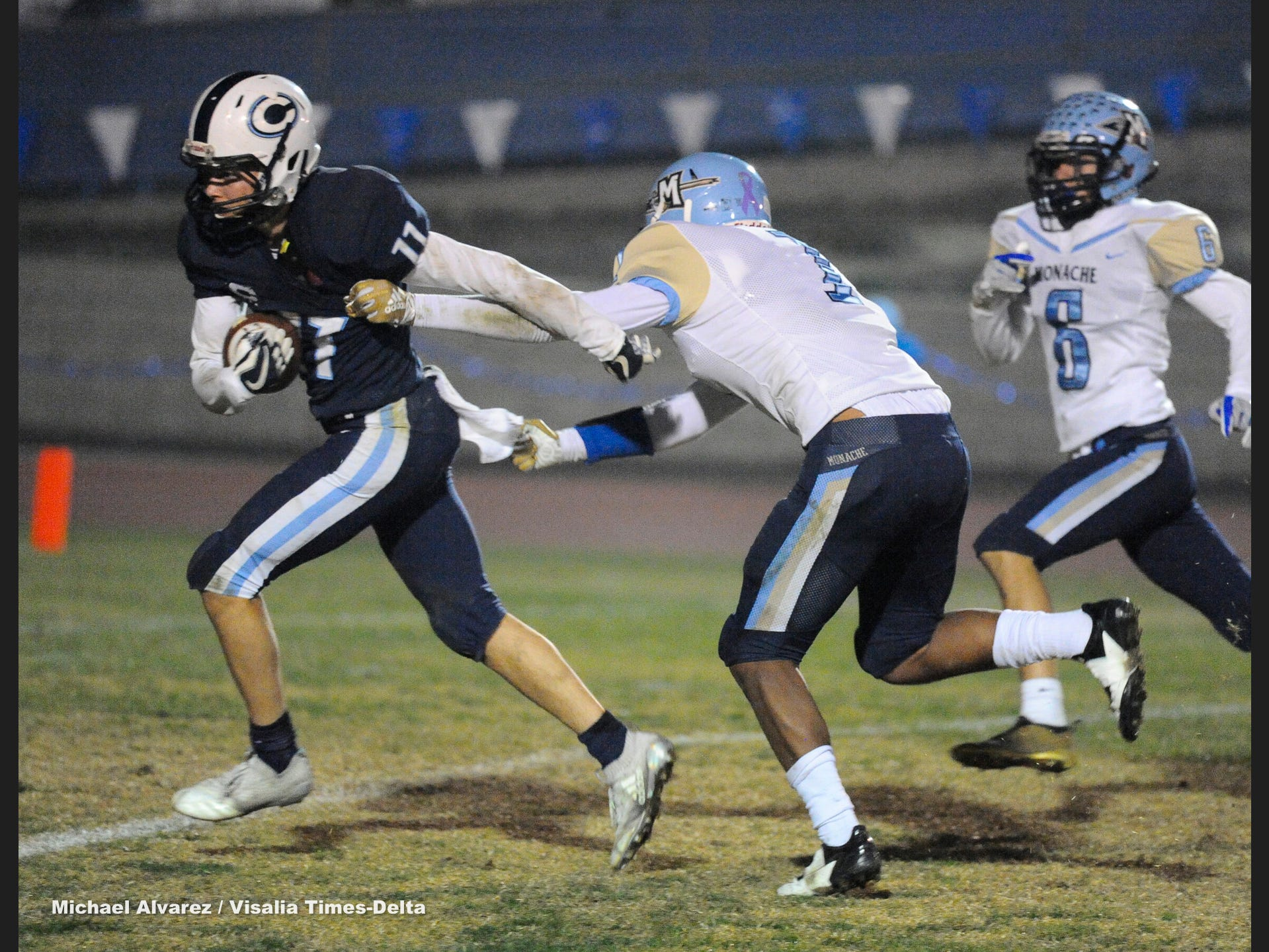 Central Valley Christian Simon Tevelde brushes off Monache during the Central Section Division IV playoff on November 16, 2018.