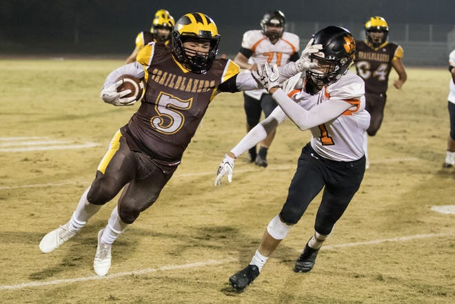 Golden West senior Christian Ortiz fights for extra yardage against Wasco on Friday in a playoff game.