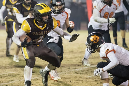 Golden West's Lonnie Wessel runs against Wasco on Friday in a playoff game.