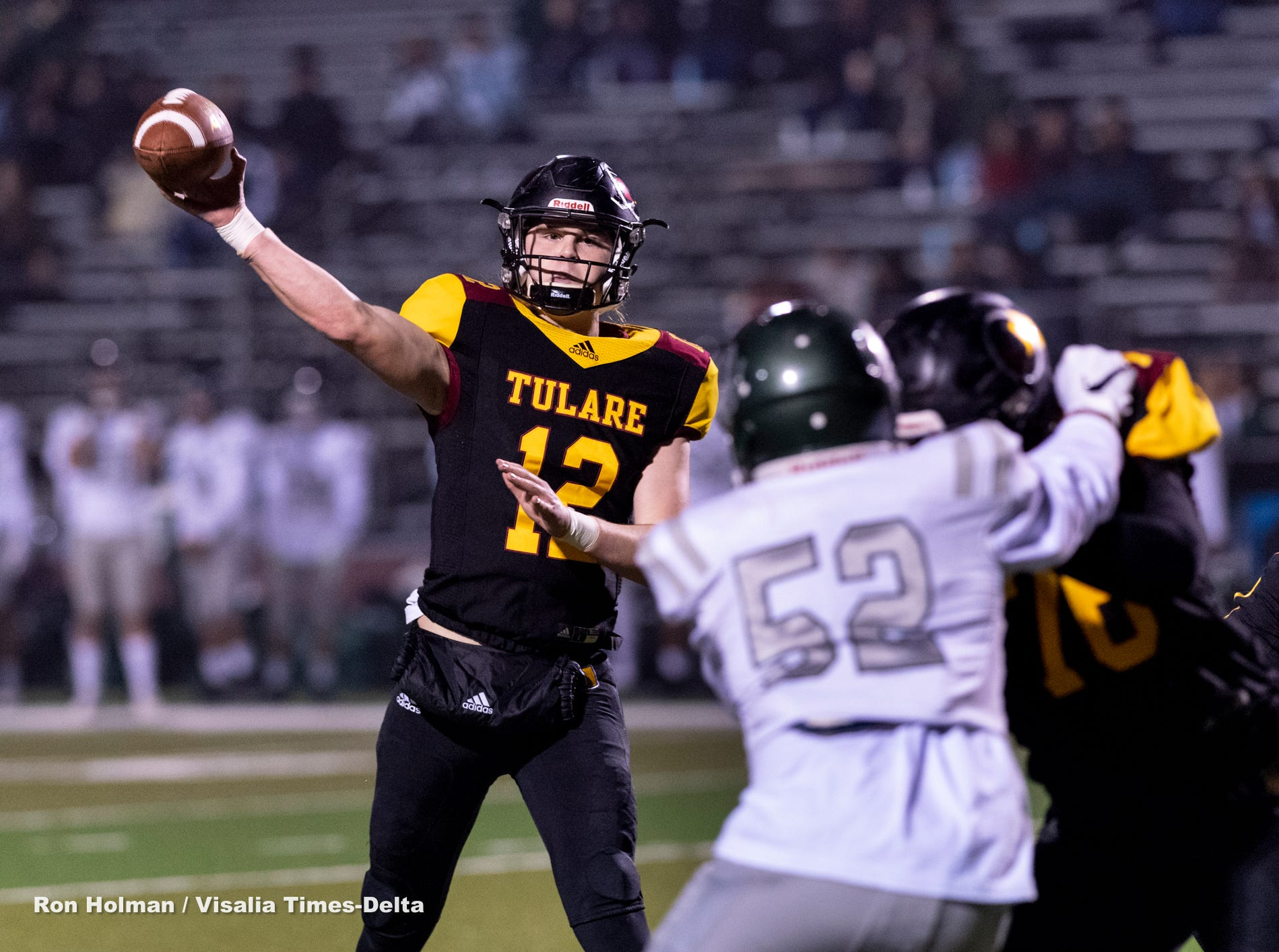 Tulare Union's Nathan Lamb passes against Dinuba in a Central Section Division II semifinal high school football playoff on Friday, November 16, 2018.