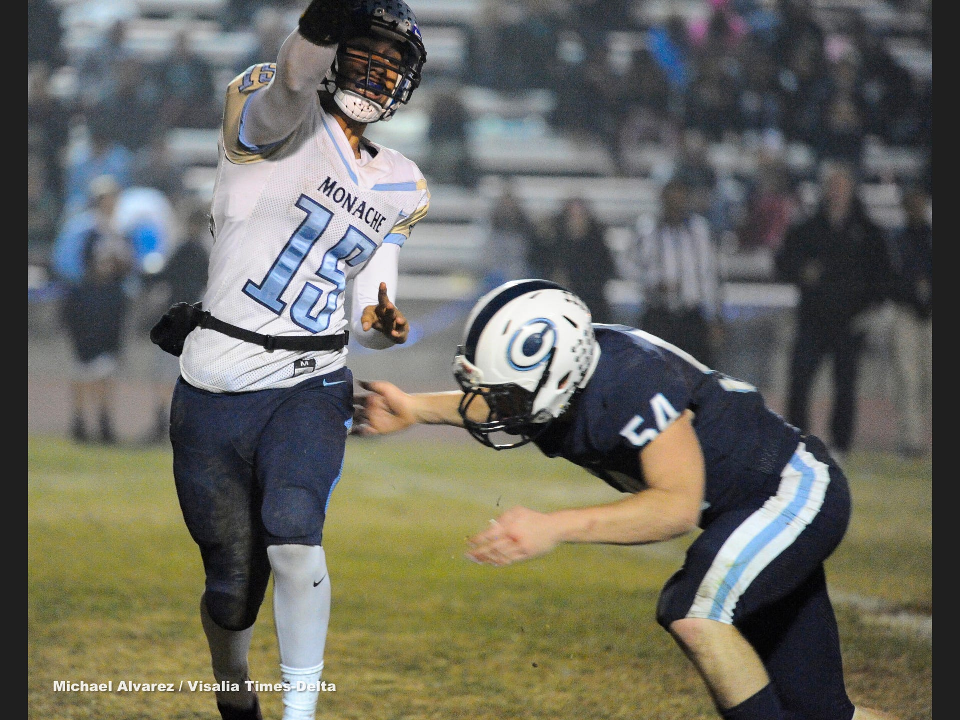Monache Antonio Andrade just gets the passed as Central Valley Christian Noah Nyenhuis goes for the tackle during the Central Section Division IV playoff on November 16, 2018.
