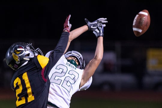 Tulare Union's Zahid Hernandez, left, breaks up a pass intended for Dinuba's Jacob Huerta in a Central Section Division II semifinal high school football playoff on Friday, November 16, 2018.