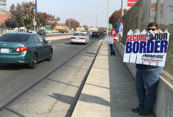 Protesters demonstrate at the Prosperity Avenue overpass in Tulare.