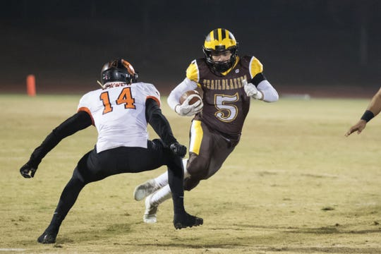 Golden West's Christian Ortiz runs against Wasco on Friday in a playoff game.