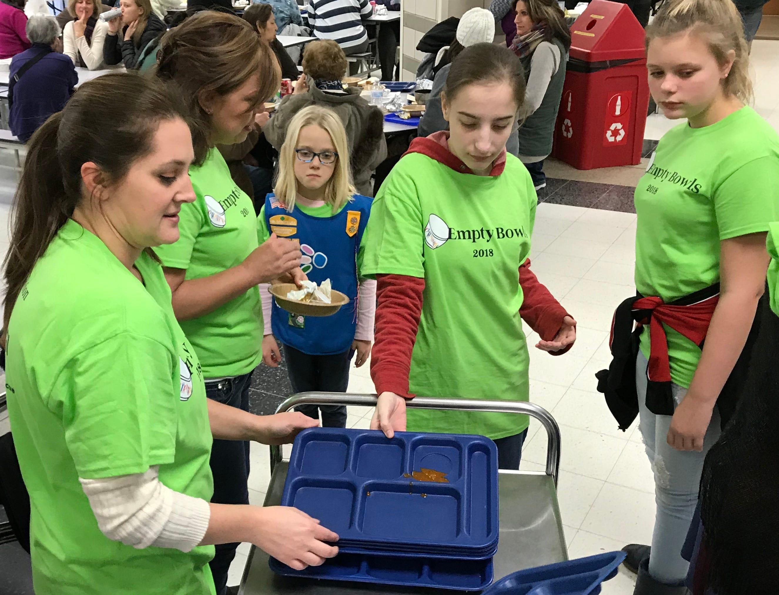 Volunteer clean up crew, working hard.