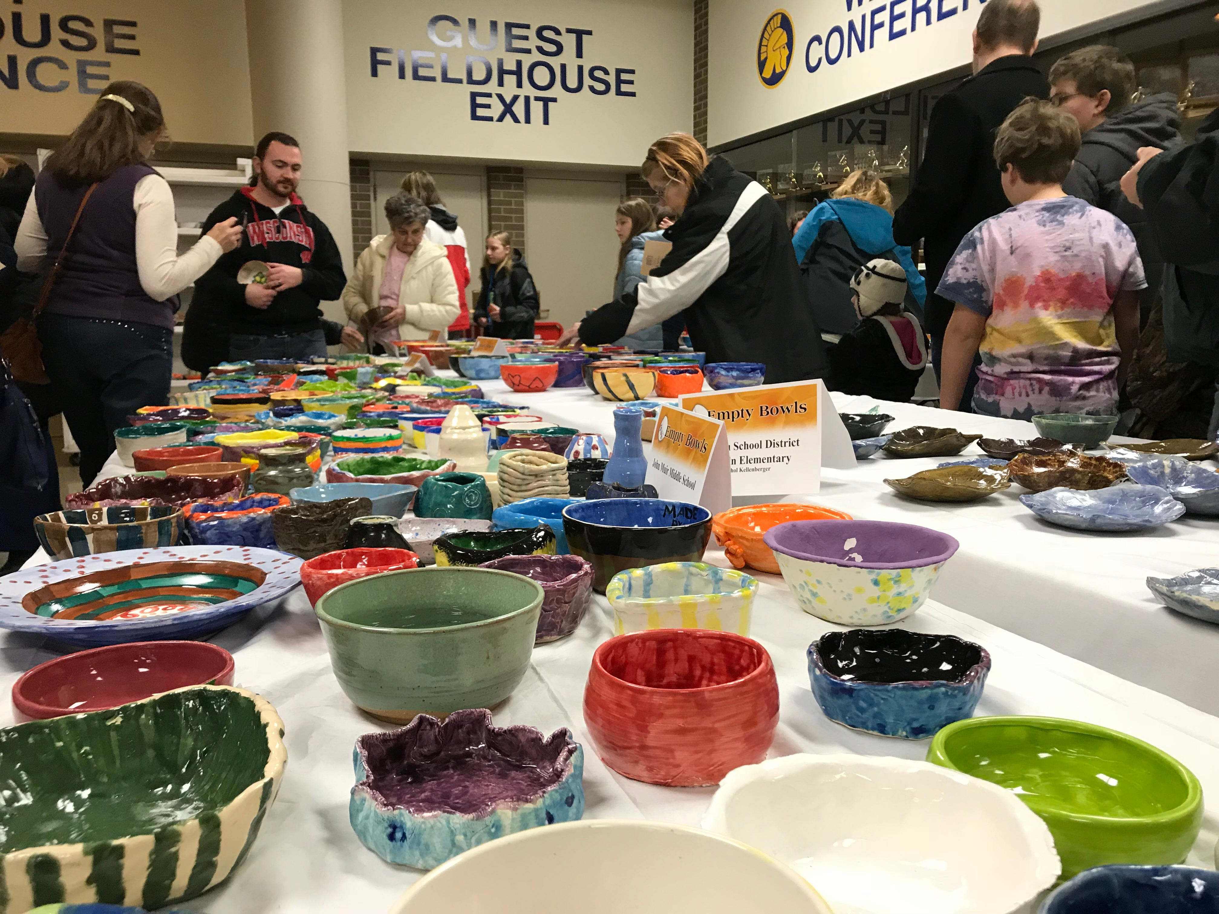 People check out a wide variety of handmade bowls.