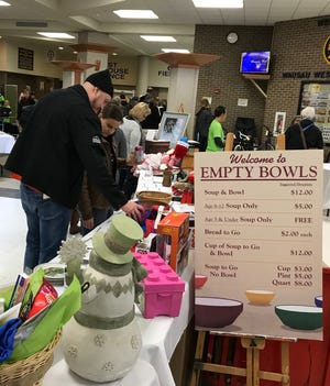 There will be no crowds at this year's Empty Bowls fundraiser for The Neighbors' Place. Instead of one large, in-person luncheon, the event will be held online, and soups and bowls will be sold separately at different businesses across the Wausau area.