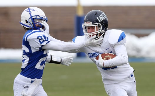 Dobbs Ferry's Jack Baglieri (20) breaks away from Ogdensburg'sEli Bullock (28) during the state Class C semifinal game at Middletown High School Nov. 17, 2018.